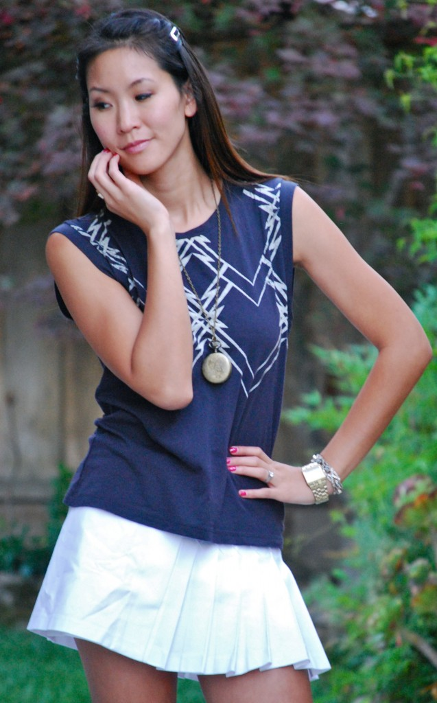 Geometric Tee and White Pleated Mini Skirt