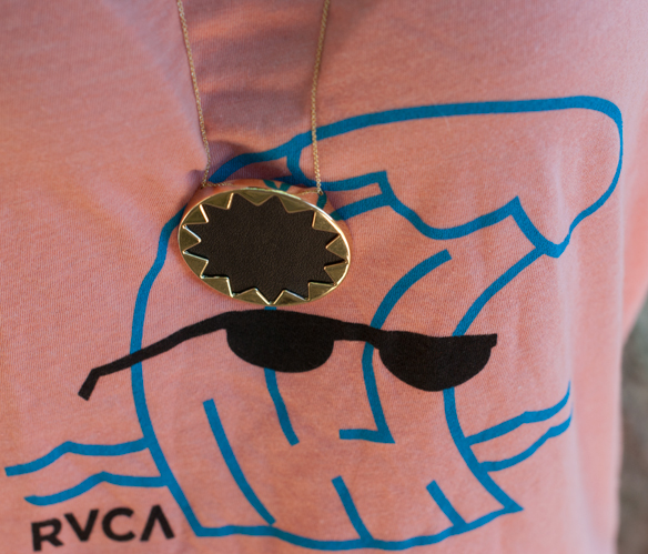 RVCA wavy coral tank and House of Harlow sunburst necklace